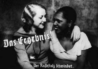 "A propaganda slide depicting friendship between an Aryan woman and a black woman as a loss of racial pride. The caption reads, ""The result: racial pride fades."""
